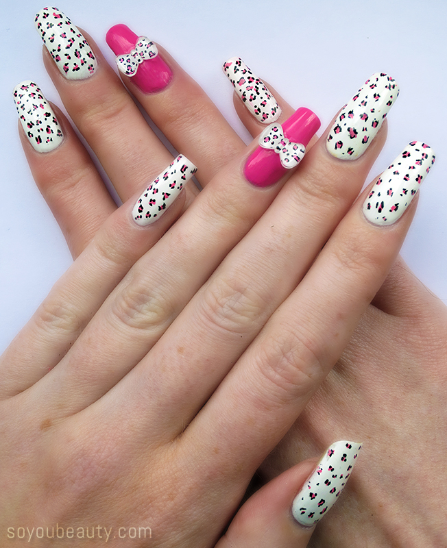 white and pink leopard nails