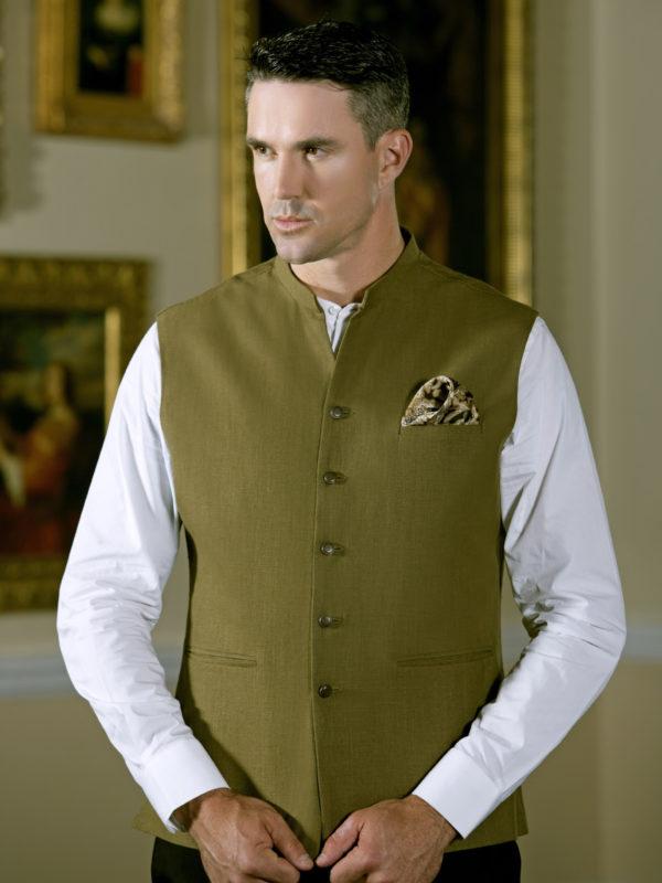 White Shalwar Kameez With Green Waistcoat